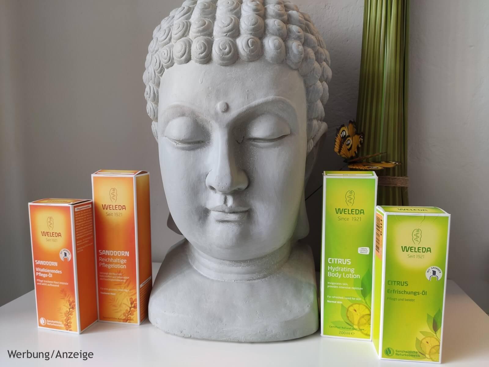 Hochwertige Weleda Öle dekoriert mit Buddha und Schmetterling